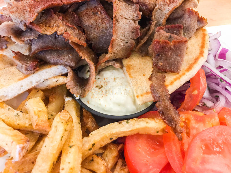 Greek gyros with fried potatoes royalty free stock images