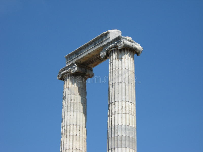 Greek ionic columns and blue sky stock photo