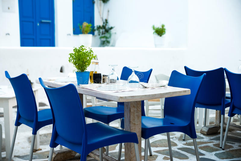 Greek island restaurants with colorful tables stock photo