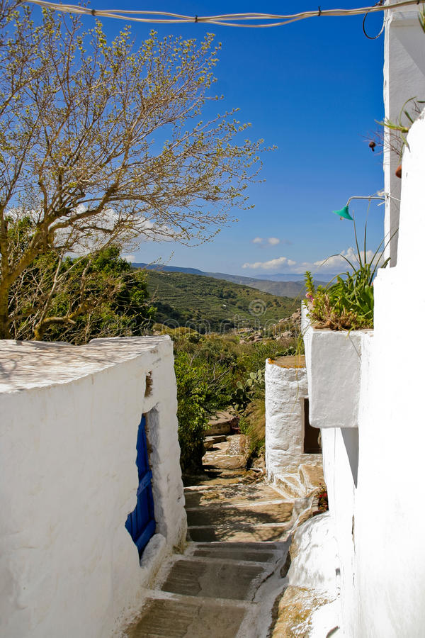 Greek island village alley. In spring stock images