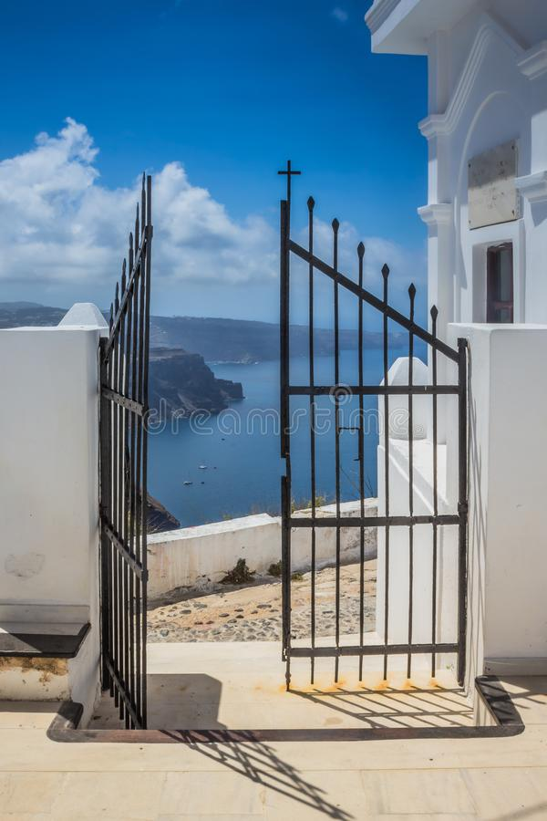 View of the sea and caldera taken from a church courtyard on the island of Santorini royalty free stock photo