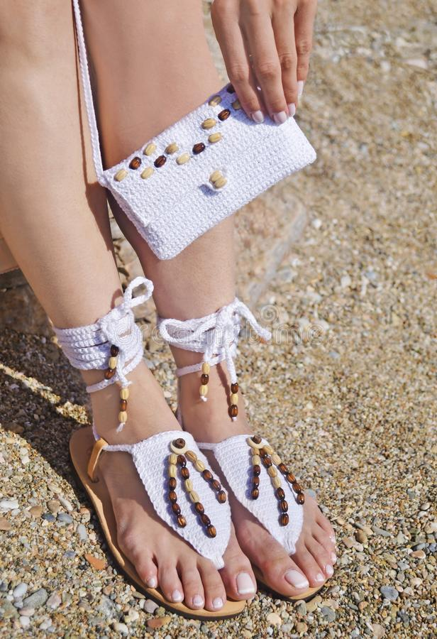 Greek leather sandals and white cotton bag advertisement on the beach royalty free stock photo