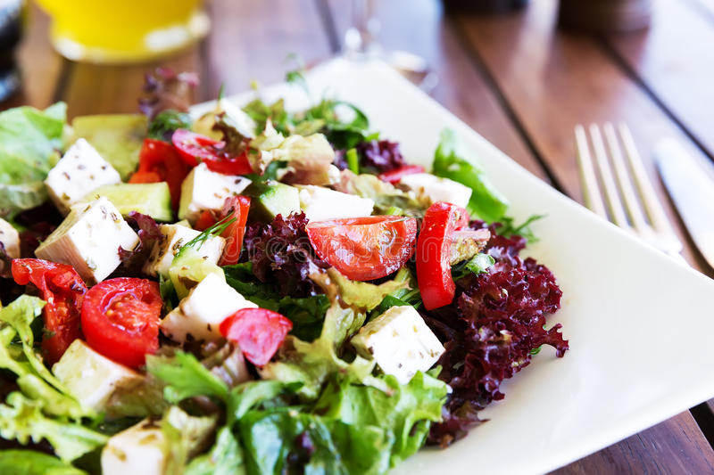 Greek Mediterranean salad with feta cheese, olives and peppers royalty free stock image