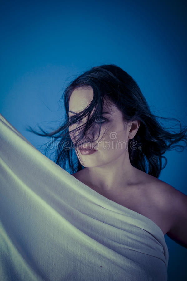 Greek muse with white veil, beautiful brunette woman with long c royalty free stock photography