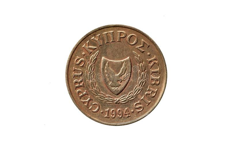 Greek old 20 cents coin Coat of Arms of Cyprus. Greek old 20 cents coin dated 1994 with an image of the Coat of Arms of Cyprus cut out and isolated on a white stock images