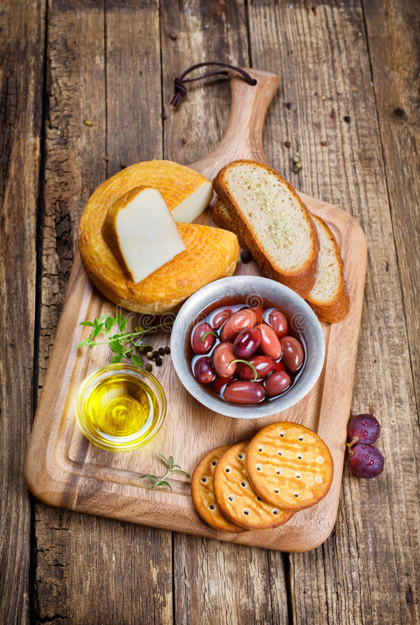 Greek olives, cheese and extra virgin Olive oil stock photography
