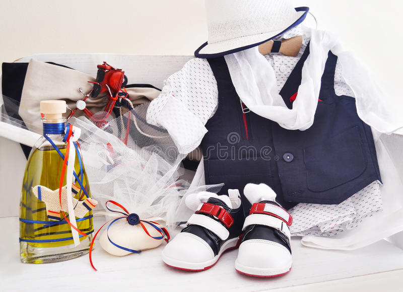 Greek Orthodox christening objects - baby clothes, shoes, baptism oil, soap and candles stock photos