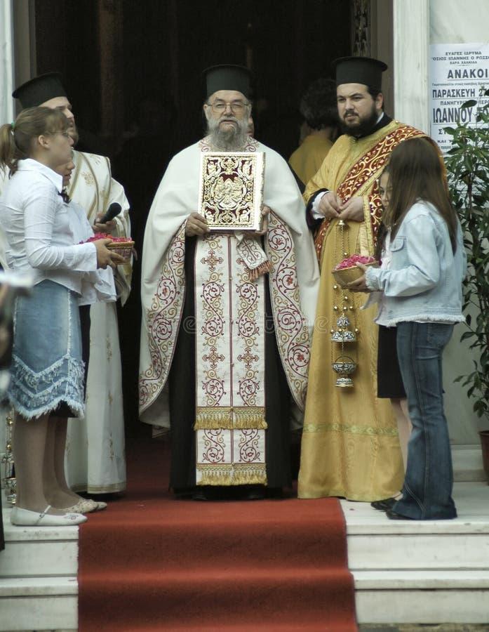 Greek Orthodox leader starting the celebration honoring Saint John the Russian royalty free stock image