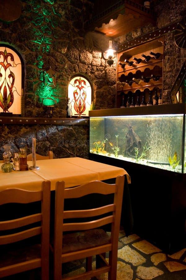 Greek restaurant. Corner with fish tank royalty free stock photos