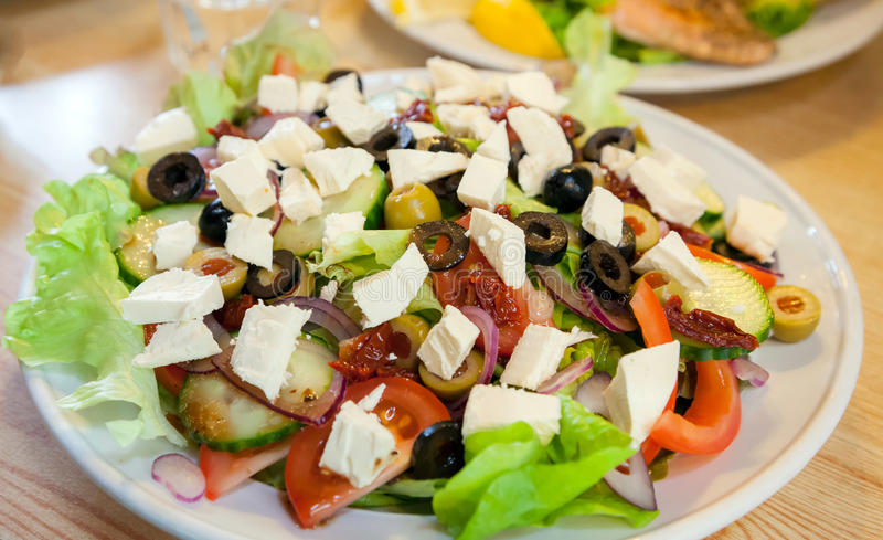 Greek Salad. With healthy vegetable and olive oil stock image