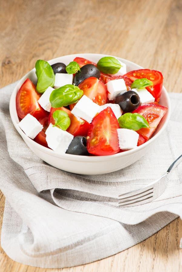 Download Greek salad in bowl stock image. Image of fork, vegetables - 28810927
