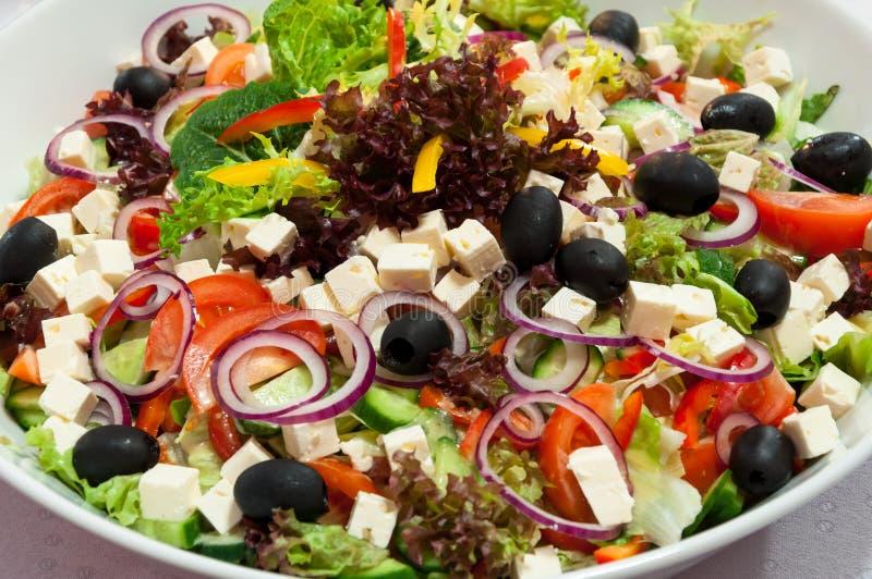 Greek salad bowl stock image