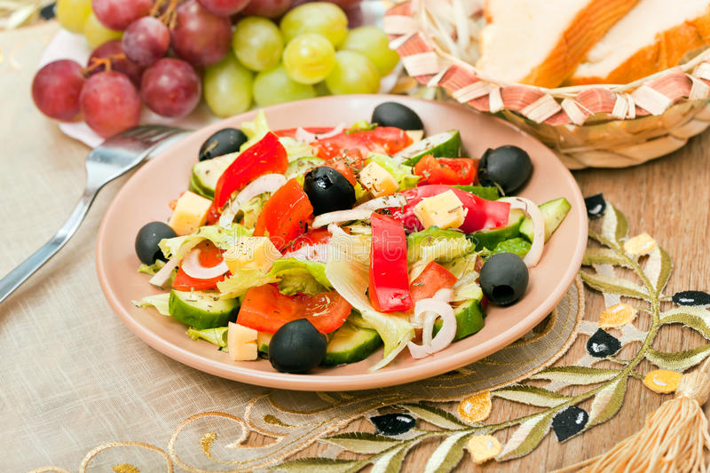 Greek salad and bread and grape stock photography