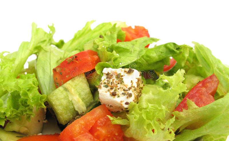 Greek salad with feta cheese, olives and fresh veg royalty free stock photography