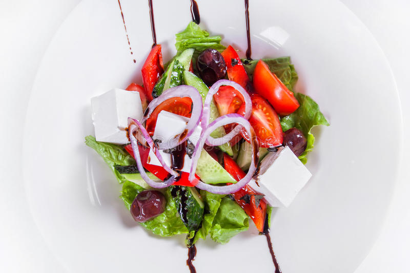 Greek salad with fresh vegetables. dish on white stock photo