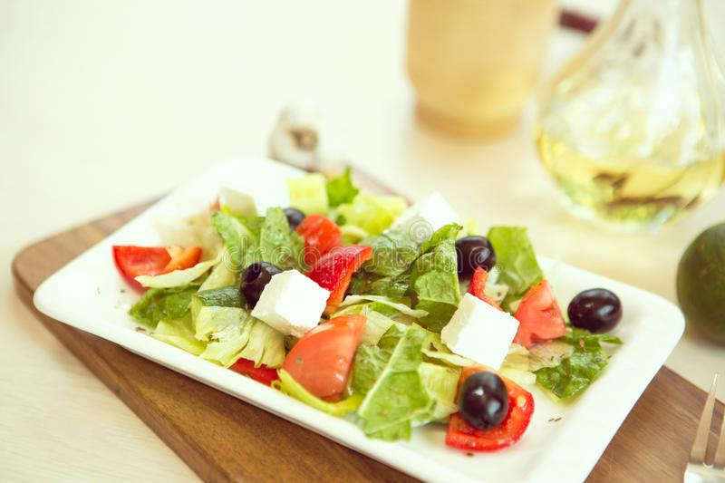 Greek salad with fresh vegetables, feta cheese and black olives. Food stock photo