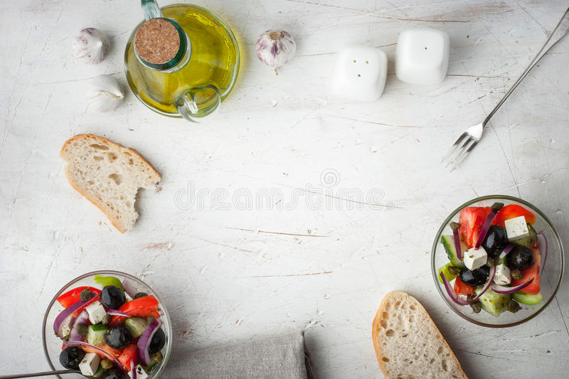Greek salad with olive oil and bread top view royalty free stock photography