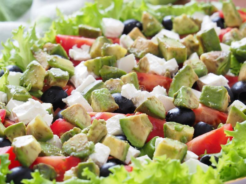 Greek Salad with olives, avocado and feta. royalty free stock image