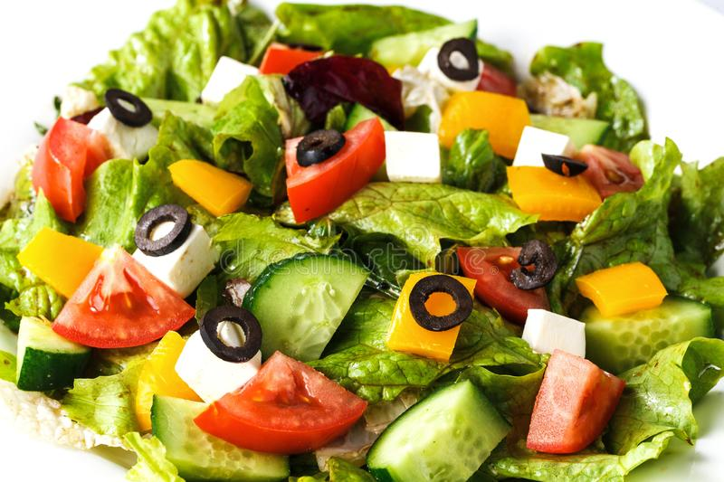 Greek salad in a plate on an isolated white background closeup stock photos