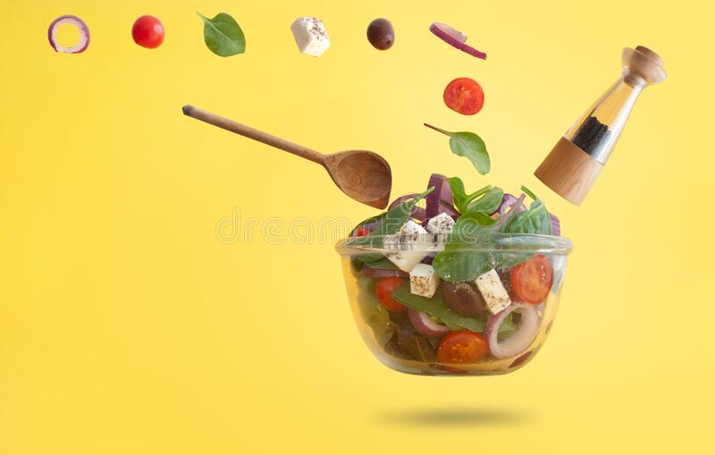 Greek salad preparation royalty free stock photo