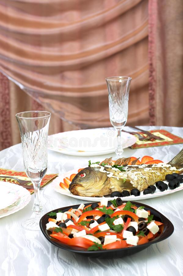 Greek salad and stuffed fish royalty free stock photo
