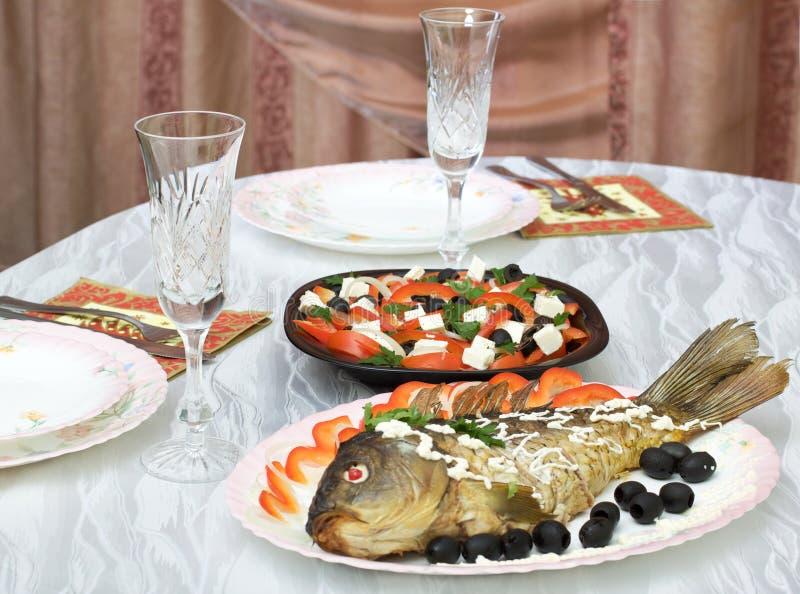 Greek salad and stuffed fish stock photography