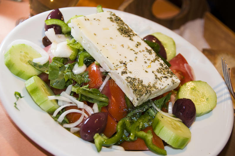 Greek salad in taverna restaurant royalty free stock photography