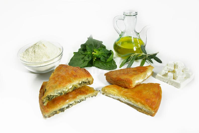 Greek pie with spinach or cheese feta olive oil stock photos