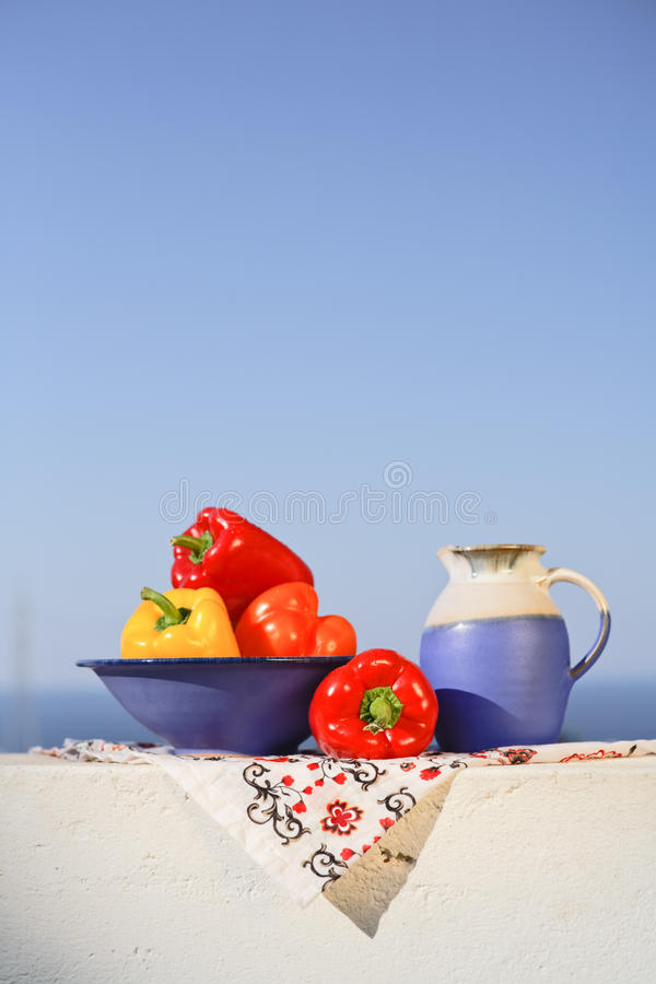 Greek still life with peppers and wine can stock images