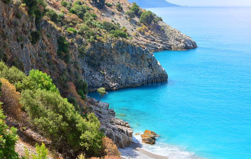Greek style seascape with mediterranean sea and rocks stock photography