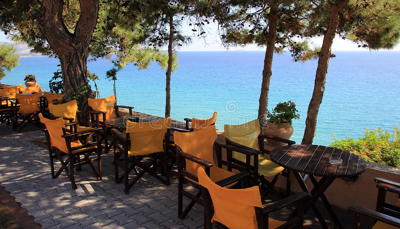 Greek taverna by sea stock images