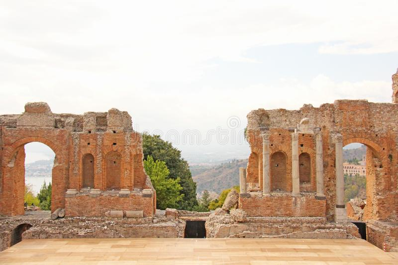 Greek Theater in the City of Taormina, Sicily Island, Italy. Old and Ancient Stone Ruins. Old Greek Columns, Greek Style.  stock image