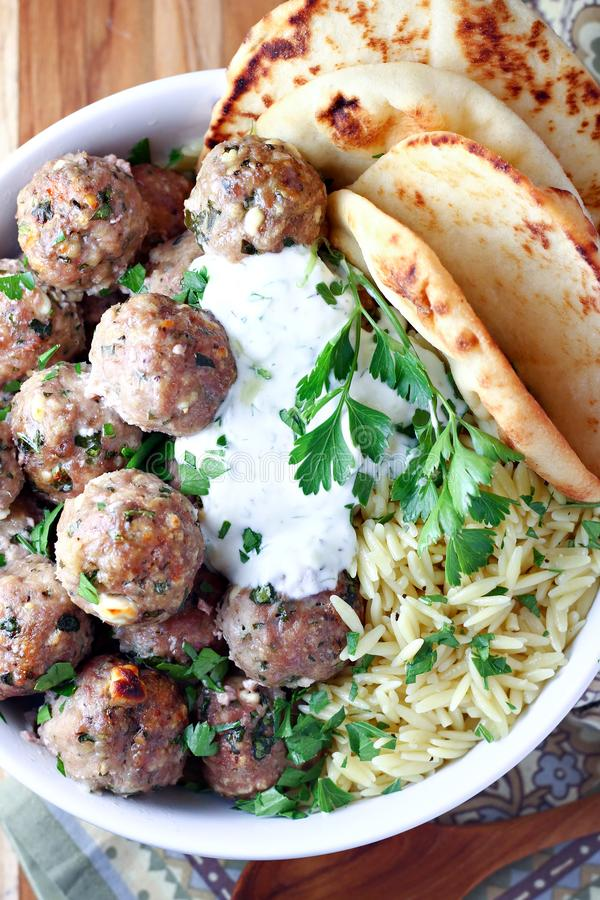 Greek Turkey Meatballs with Tzatziki Sauce royalty free stock images