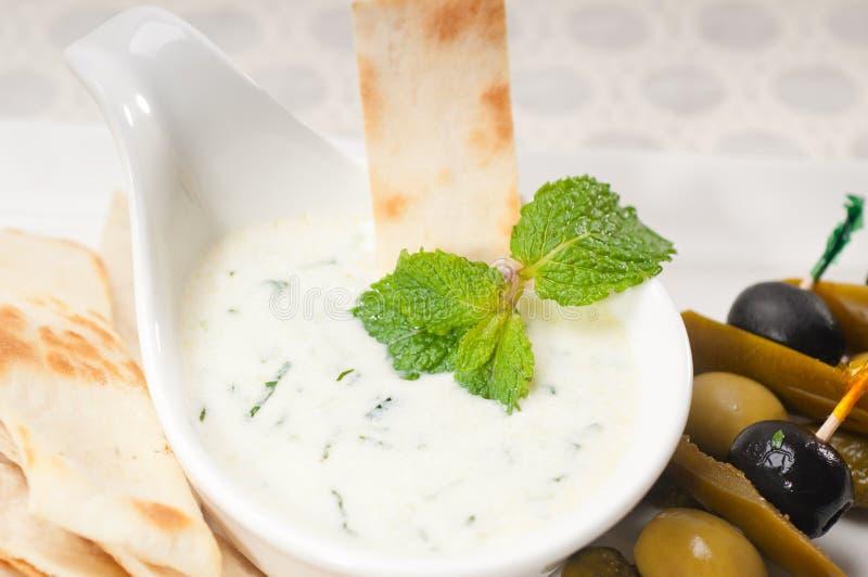 Greek Tzatziki yogurt dip and pita bread. Fresh Greek Tzatziki yogurt dip and pita bread and pickels stock images