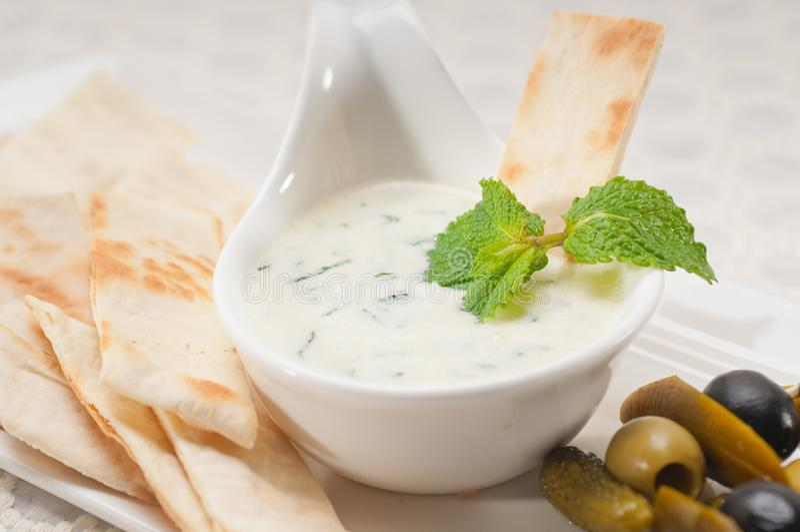 3947941 greek tzatziki yogurt dip and pita bread. Greek tzatziki yogurt dip and pita bread stock photo