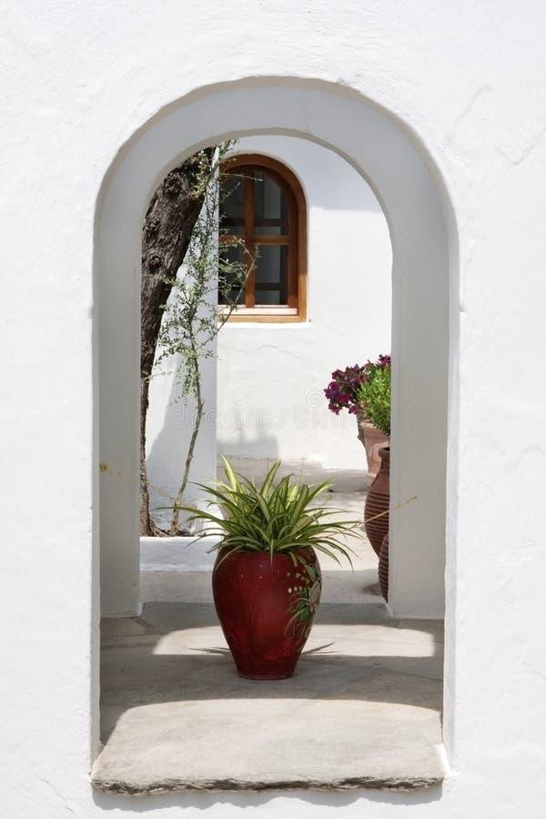 Greek vase in monastery garden royalty free stock photo