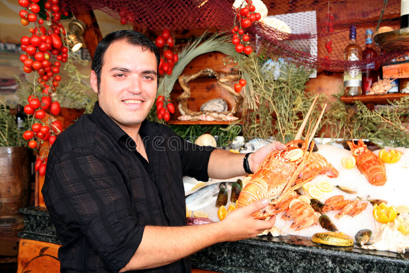 Greek waiter with lobster royalty free stock photography