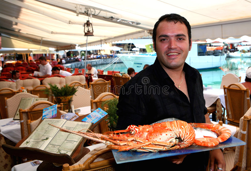 Download Greek Waiter With Lobster Stock Photography - Image: 5353172