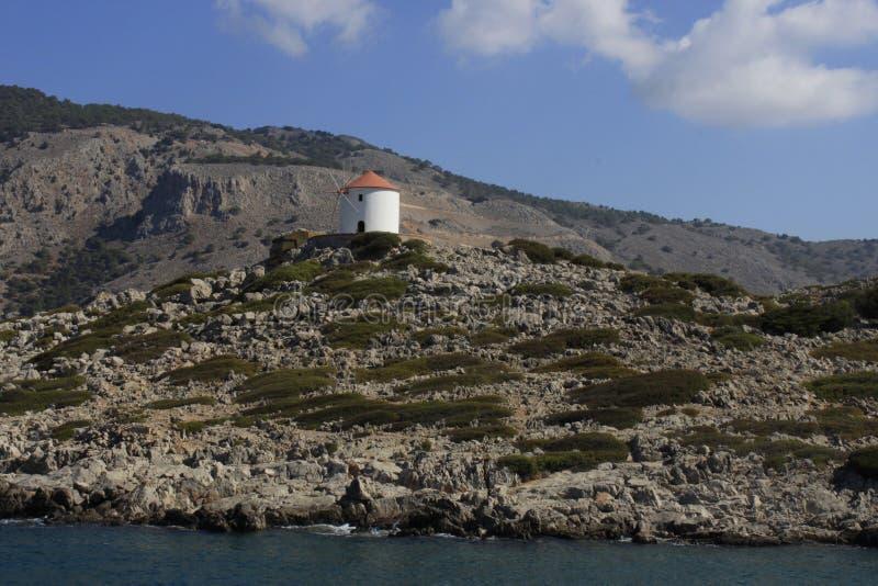 Greek windmill on the island of Symi royalty free stock photo