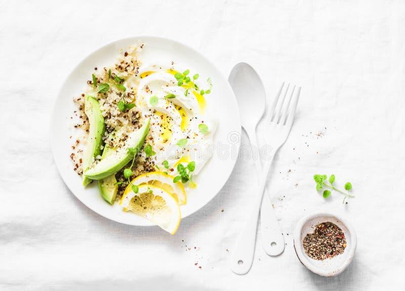 Greek yogurt, avocado, quinoa, breakfast bowl on white background, top view. Healthy diet food. Concept royalty free stock photos