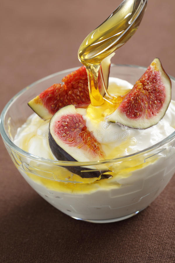 Greek yogurt with figs and honey royalty free stock image