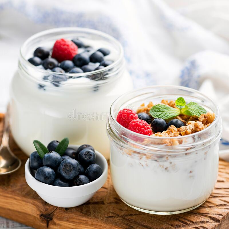 Greek yogurt with granola and berries royalty free stock photos