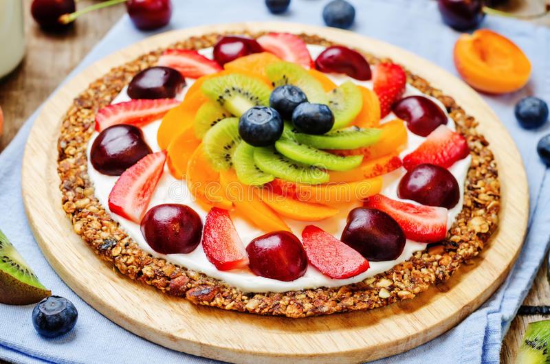 Greek yogurt granola fruit breakfast pizza stock images