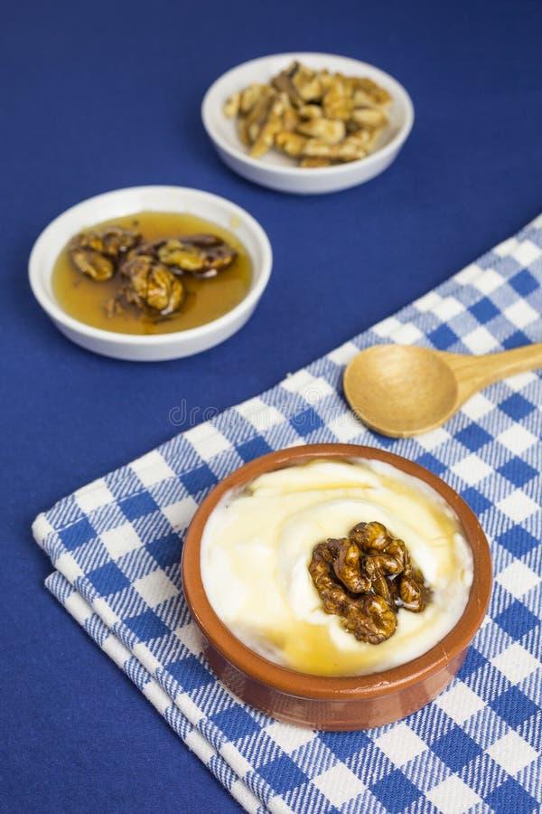 Greek yogurt with honey and walnuts stock images