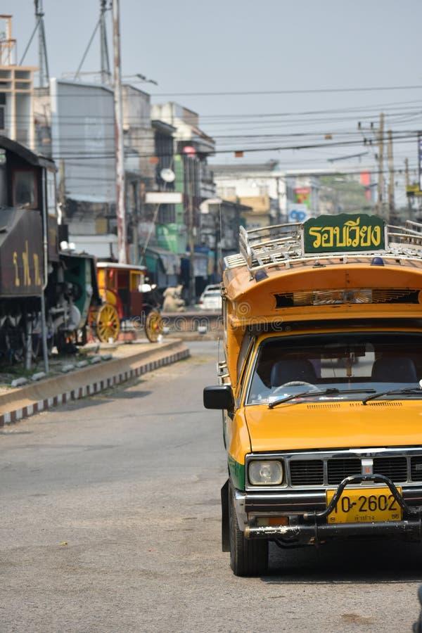 Green and yellow public car of Lampang, Thailand. stock photos