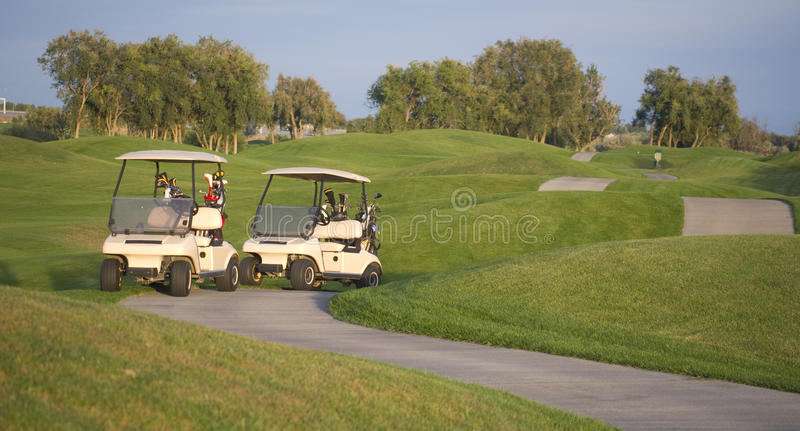 Download Town Golf Course Carts On Path Evening Sunset Stock Photo - Image: 24937056