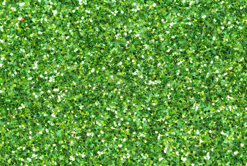 Green abstract background. Christmas glitter closeup photo. royalty free stock photography