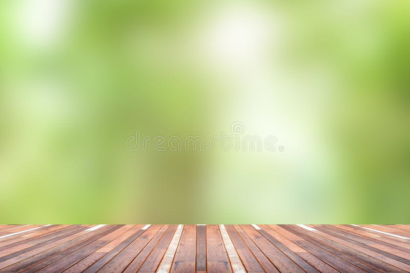 Green abstract blur nature background. With wooden floor stock images