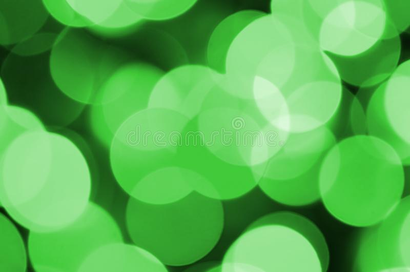 Green abstract Christmas blurred luminous background. Defocused artistic bokeh lights image.  stock photos