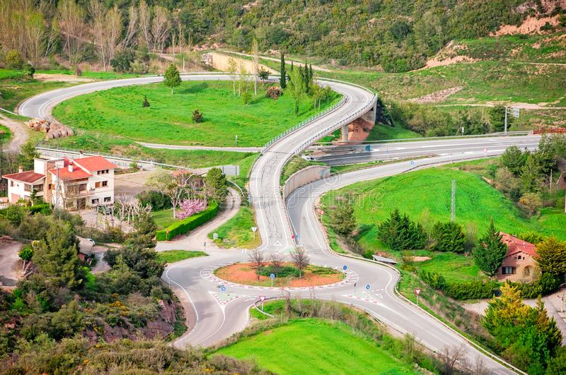 Green aerial roundabout. Aerial view of the view of the road with a circular motion. Road Signs. Green aerial roundabout. Aerial view of the view of the road stock images